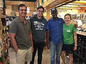 Students at Bartlett's with (from left) Bartlett's president, John Bartlett, Jack from England, Yanick from Jamaica, and Laurie from Northern Ireland