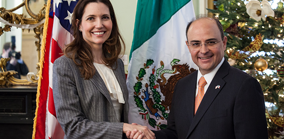 Assistant Secretary Ryan and Mexico's North American Affairs Undersecretary Martinez de Castro clasp hands after signing the letter of intent.