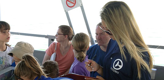 Justine, aboard the Sea Life Safari, helps a CMA Marine Biologist document sea life in the inter coastal waters.