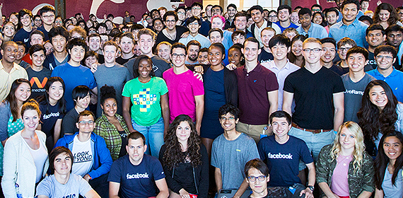 Facebook Interns take a group photo with founder Mark Zuckerberg.