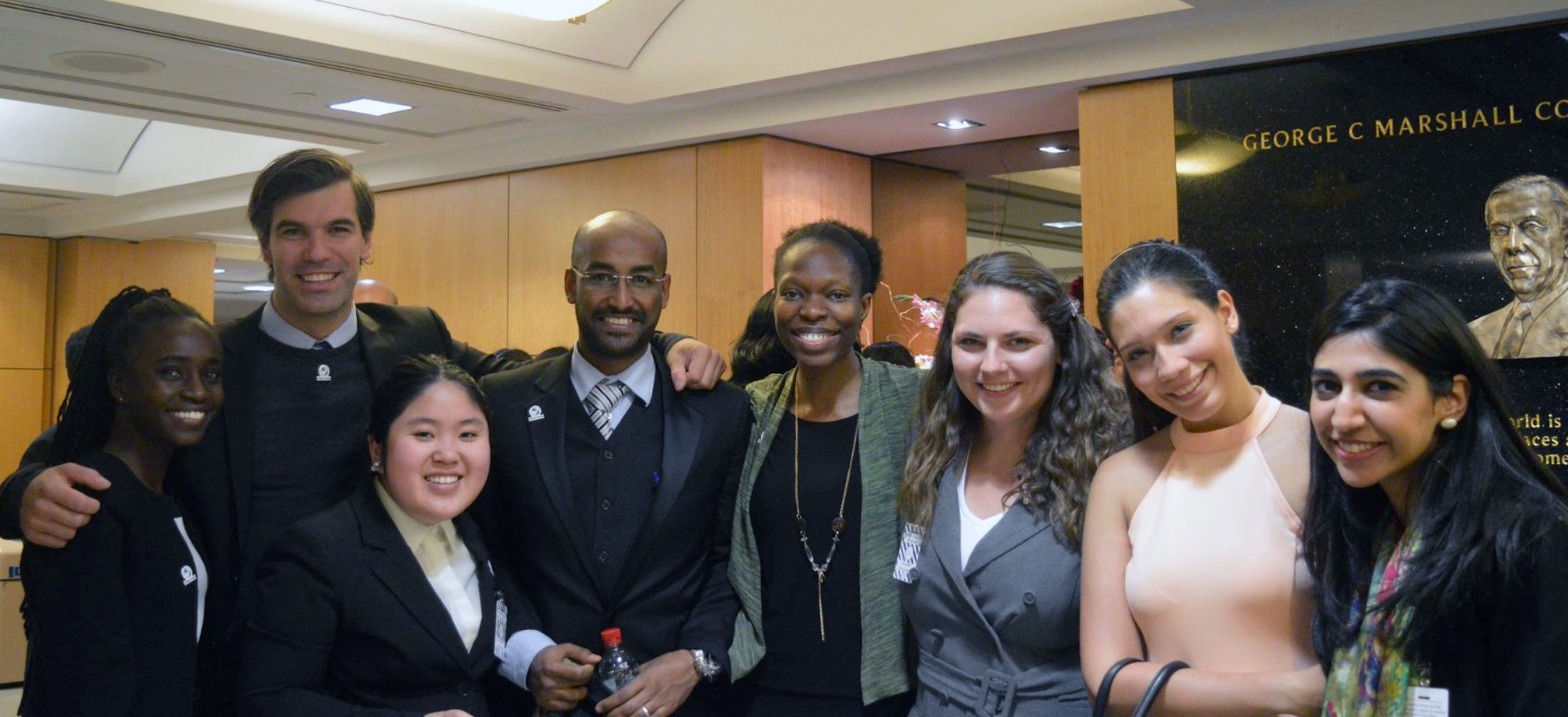EGLI Atlas Corps Fellows pose for a group photo at event reception.
