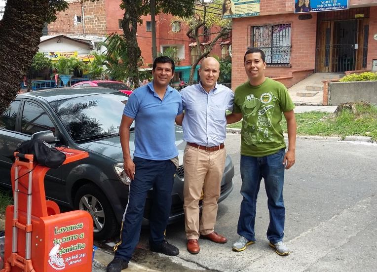 Mr. Mayorga with two employees