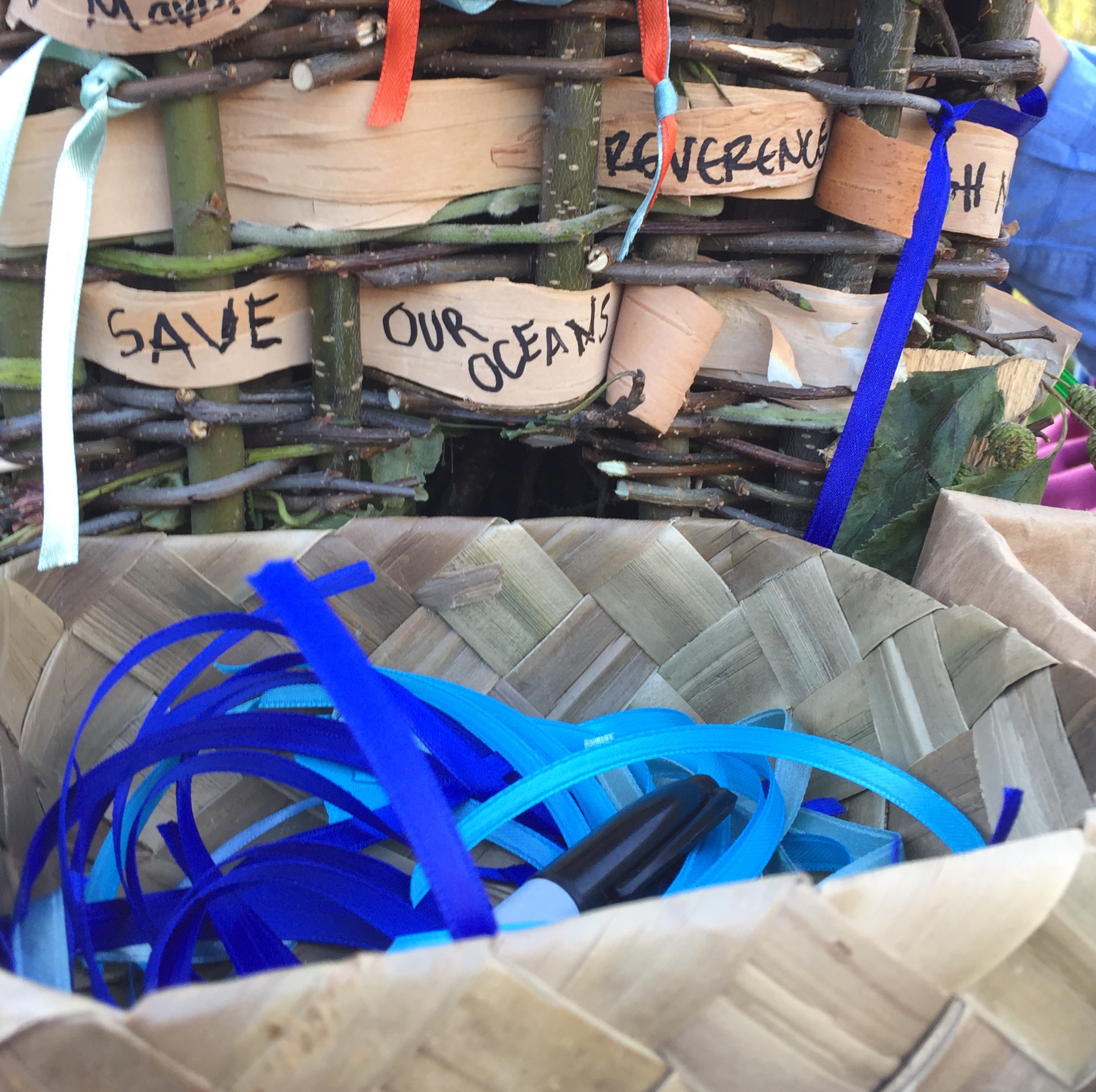 Ribbons of Solidarity used by community members to write their intentions to preserve clean water and marine life.