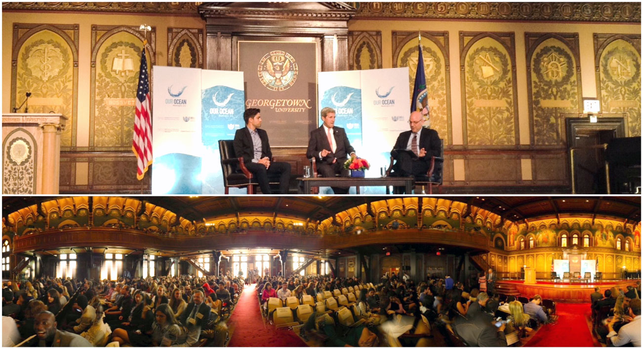 Adrian Grenier, John Kerry, and Joel Hellman lead a group discussion at Gaston Hall, Georgetown University.
