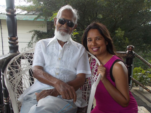 Samantha and her grandfather at their home in Trinidad and Tobago.