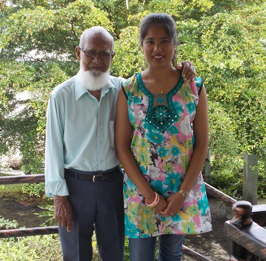 Older man and young woman stand side by side