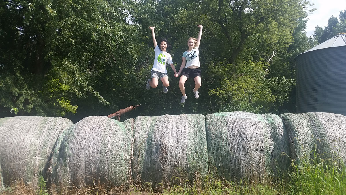 Chi-Hua of Taiwan and Chantal of Germany, both EF High School Exchange Year Class of '17, hanging out on the Schutte family farm. (Photo courtesy of EF High School Exchange Year)