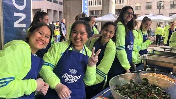 Exchange Visitors volunteer at the Boston Marathon pre-race pasta dinner. Credit: Gisela Nilsson, Cultural Care Au Pair