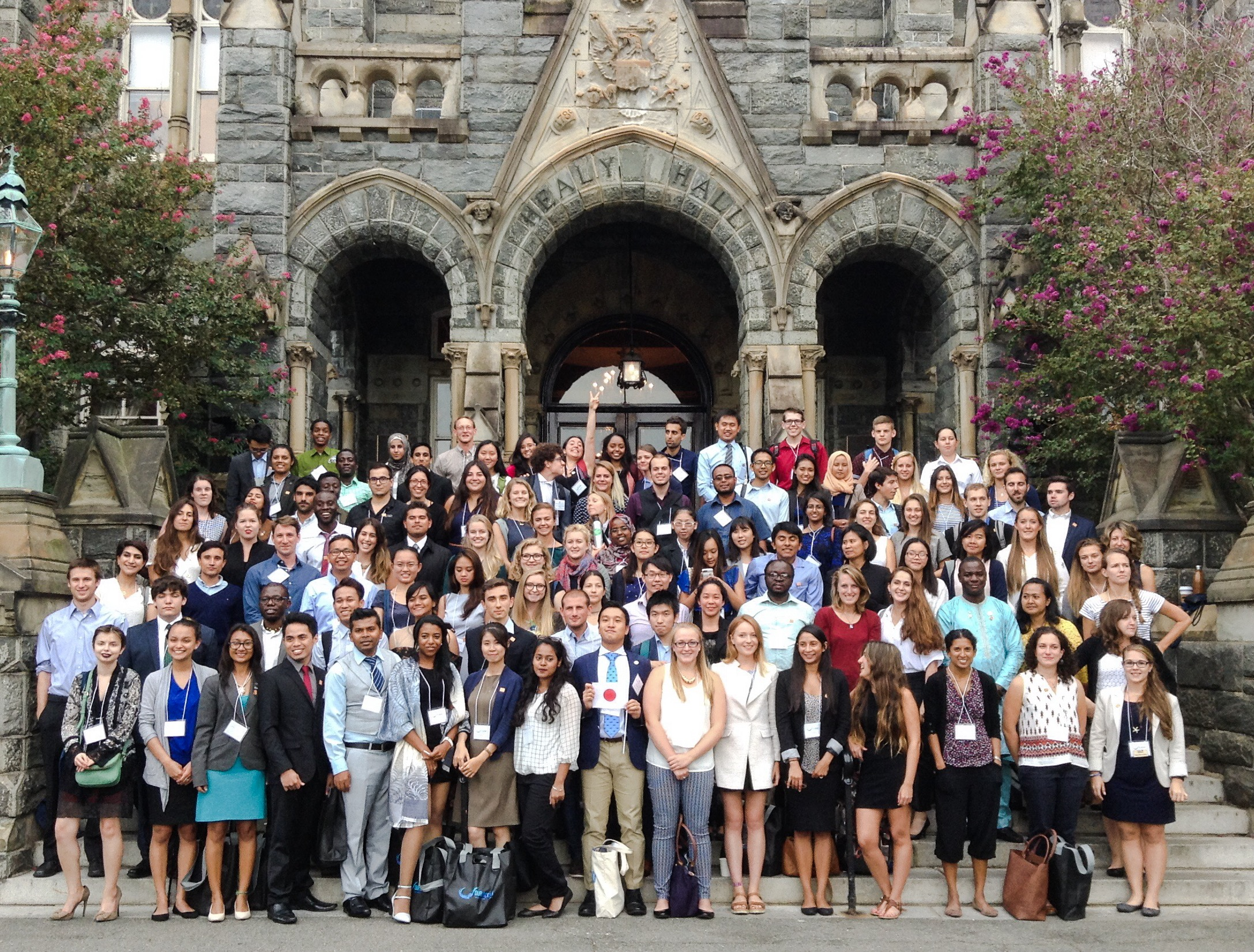 Young professionals and student participants in front of Healy Hall, Georgetown University.