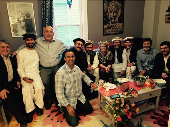 Food brings everyone together. Afghani and Pakistani international visitors, pictured here,break bread with a Vermont family.