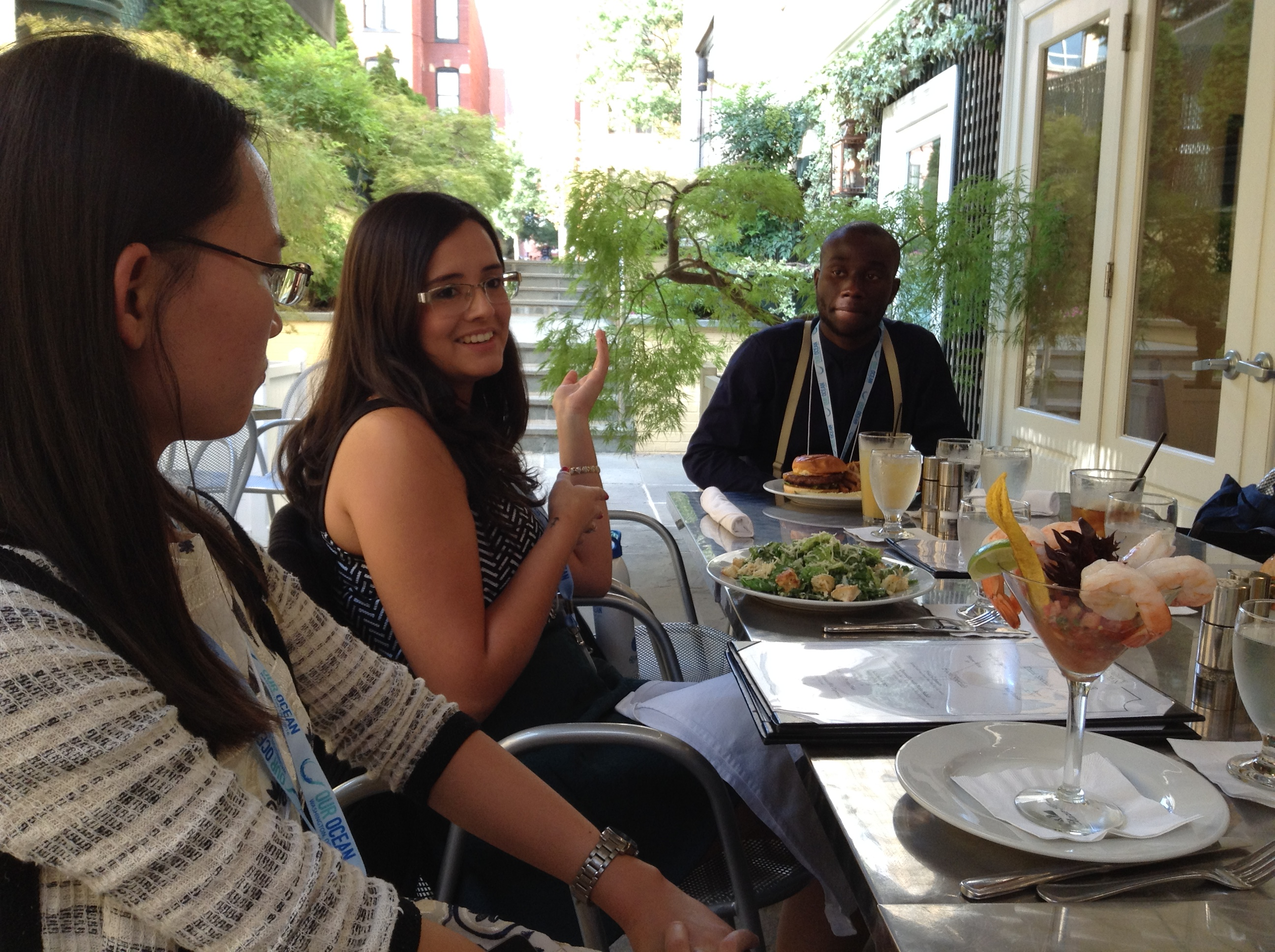 Luana [middle] discussing Brazil and her experience learning about environmental  issues during dinner with fellow J-1 Our Ocean participants Helen Luo (China, Research Scholar) and Nathan Apiri (Ghana, SWT)