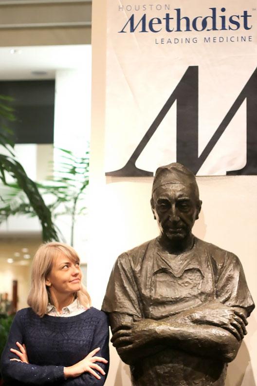 Marta admires the statue of cardiac surgeon Michael E. DeBakey at Houston Methodist Hospital.