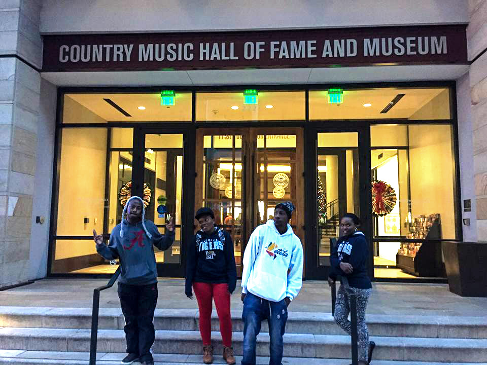 Faith (right) with friends outside the Country Music Hall of Fame and Museum.