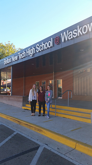 Scarlett and two high school students in front of Belton New Tech High School in Texas